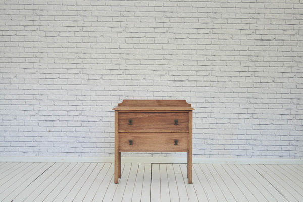 A vintage oak two drawer chest of drawers or bedside table