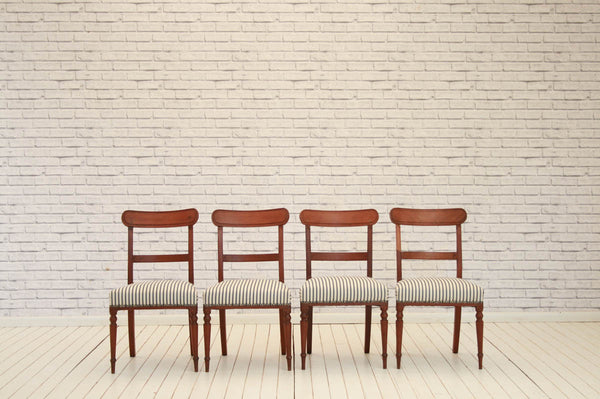 A set of four Edwardian mahogany bar-back dining chairs
