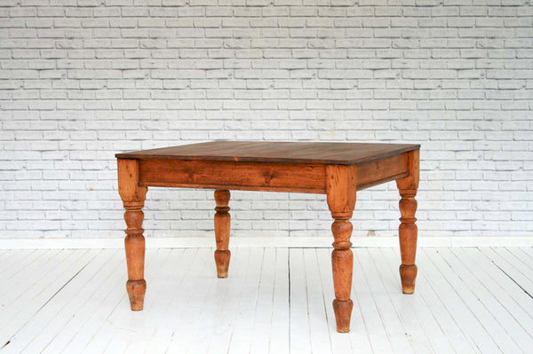 A Victorian pine kitchen table with later pine top