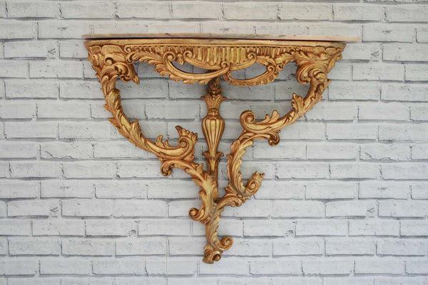 A gilt and marble wall mounted console table