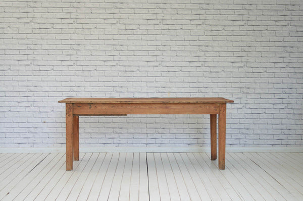 A 19th Century pine kitchen table with one single drawer
