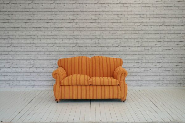 An early 20th Century two seater cottage sofa