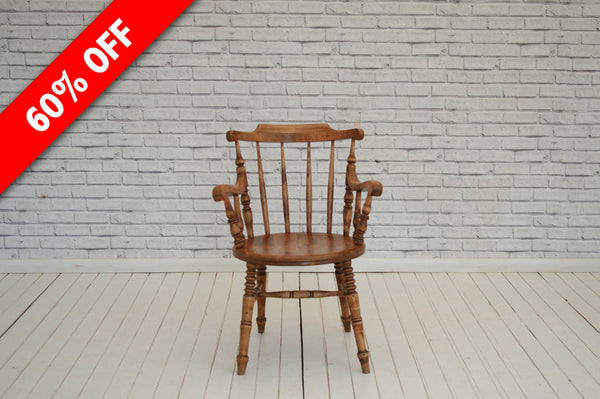 A stick back desk chair / kitchen chair