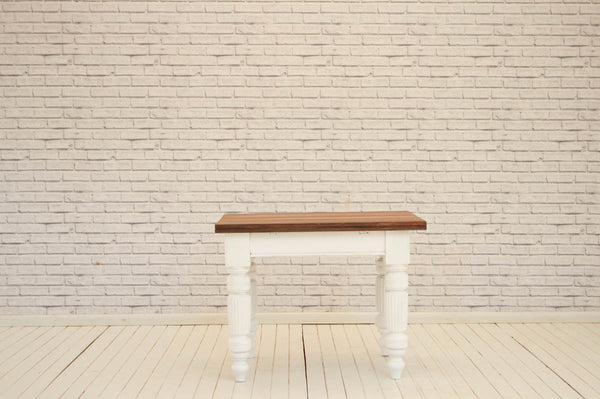 A victorian kitchen table with white painted base