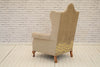 An Edwardian (1901-1910) wingback armchair
