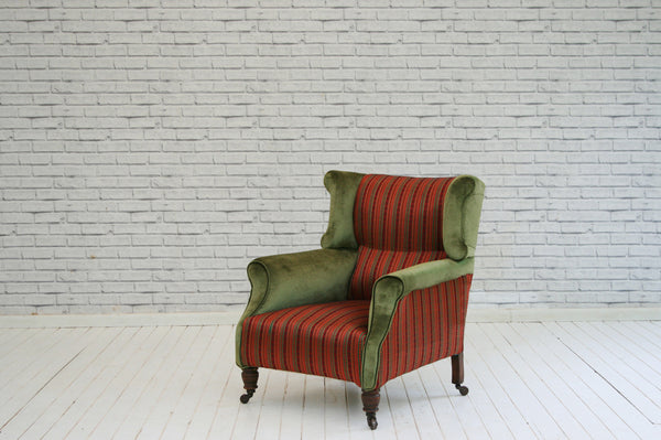 A Victorian wingback armchair in Turkish stripe silk/cotton and green velvet