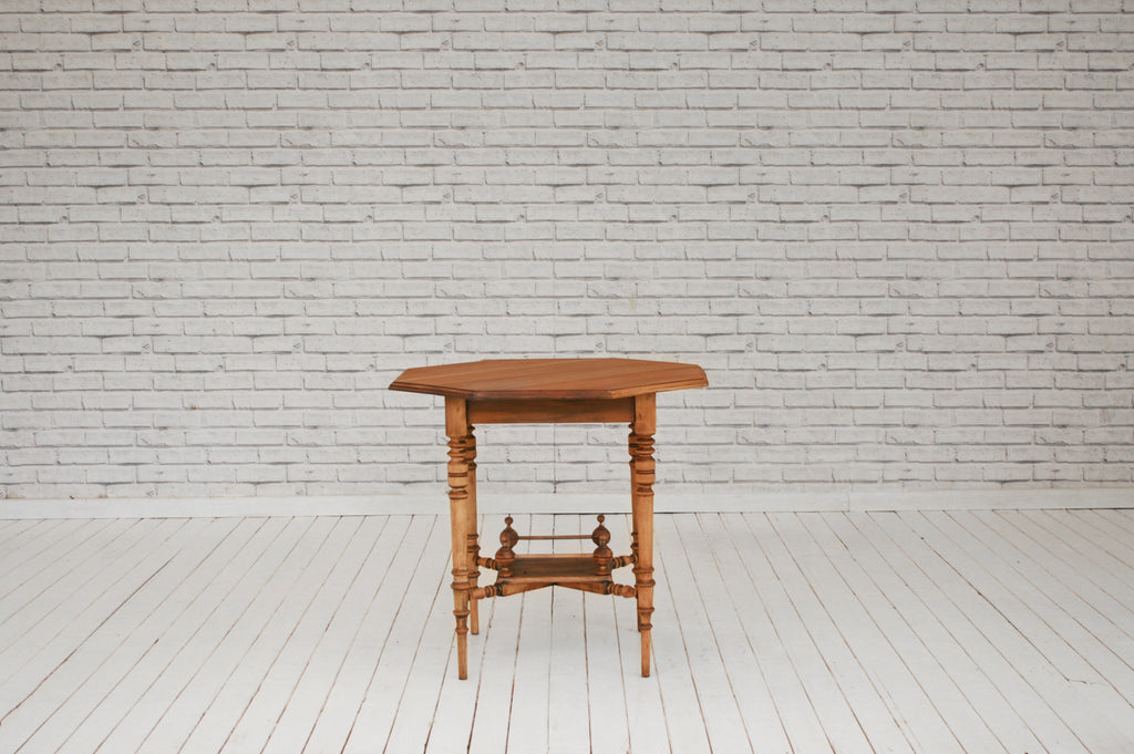 An Edwardian walnut occasional/side table
