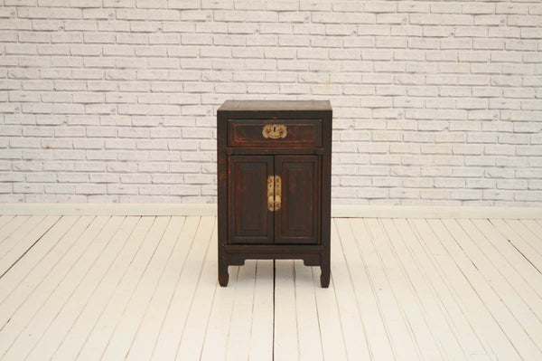 A vintage Chinese bedside table with one drawer and cupboard below