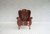 A pair of Victorian wingback armchairs in vintage Kente cloth & velvet