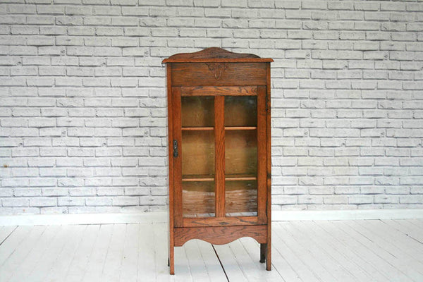 A 1930's Oak display cabinet