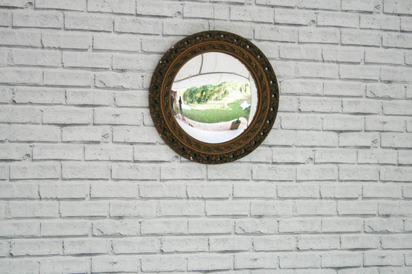 A gilt framed convex wall mirror