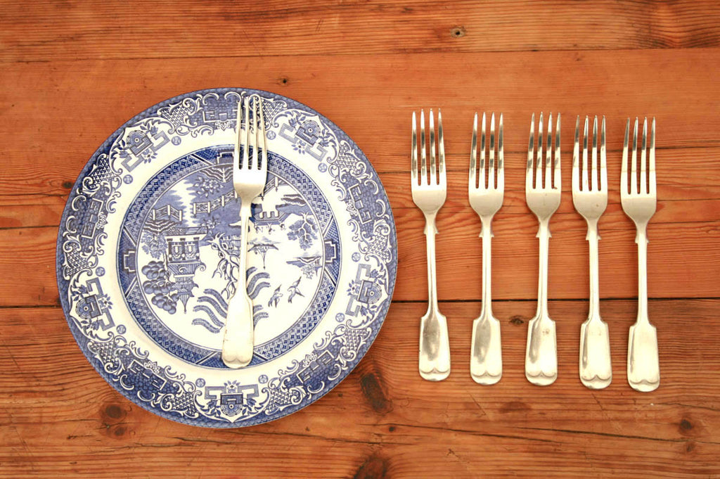 A set of six silver plated table forks