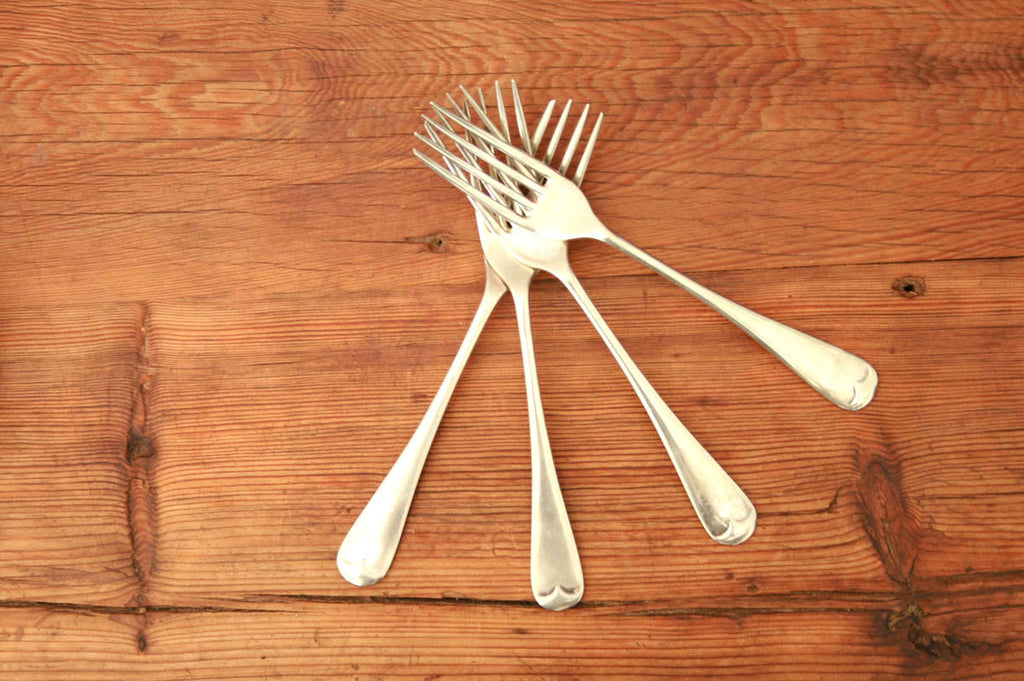 A set of four silver plated dinner forks