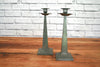 A pair of vintage pewter candlesticks