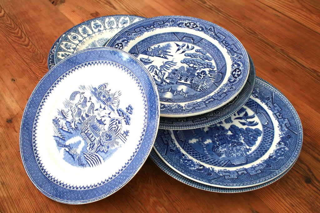 Blue and white patterned mismatching dinner plates