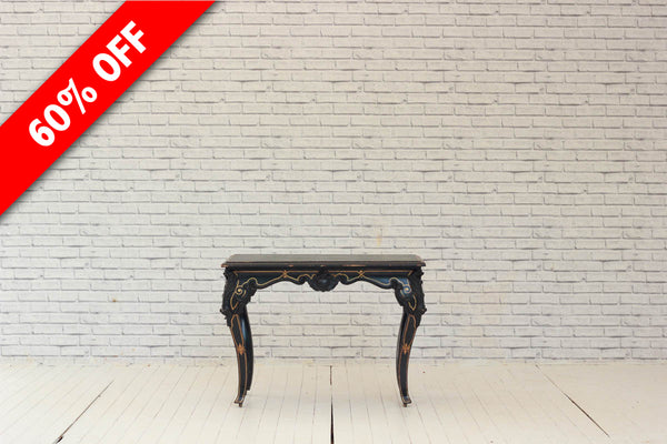 A French ebonised and gilt console table with green leatherette top