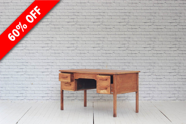 A 1960's oak three drawer desk