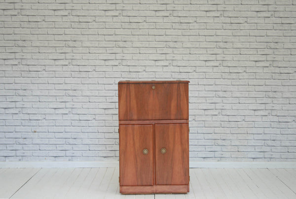 A 1950's Walnut drinks cabinet / cupboard