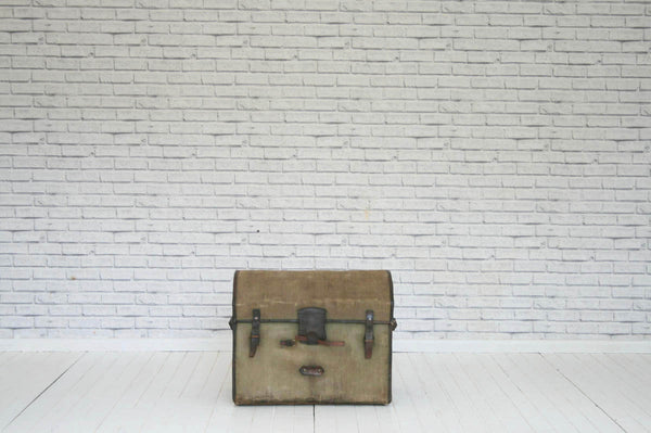 A vintage canvas & leather  dome top travelling trunk