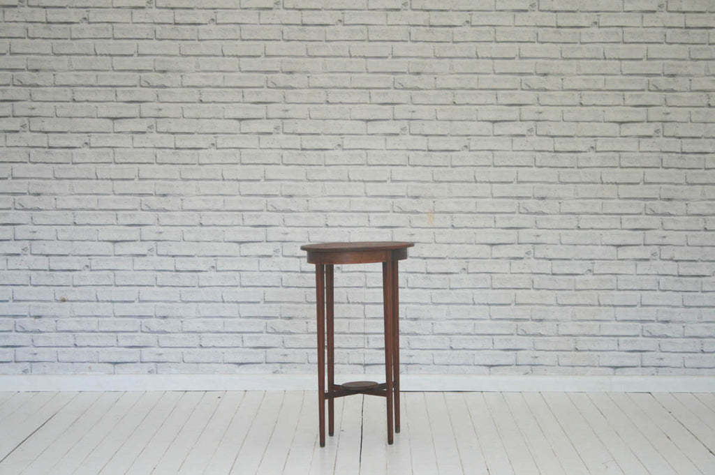 A mahogany two tier side table