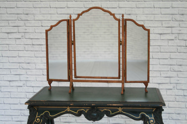 A charming table top 3 fold dressing mirror