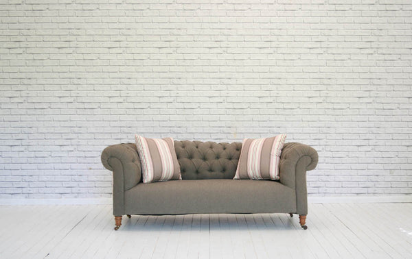 A Victorian two seater deep buttoned chesterfield sofa