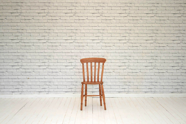 An elm seated slat back kitchen chair