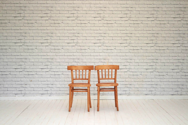 A pair of bentwood kitchen chairs