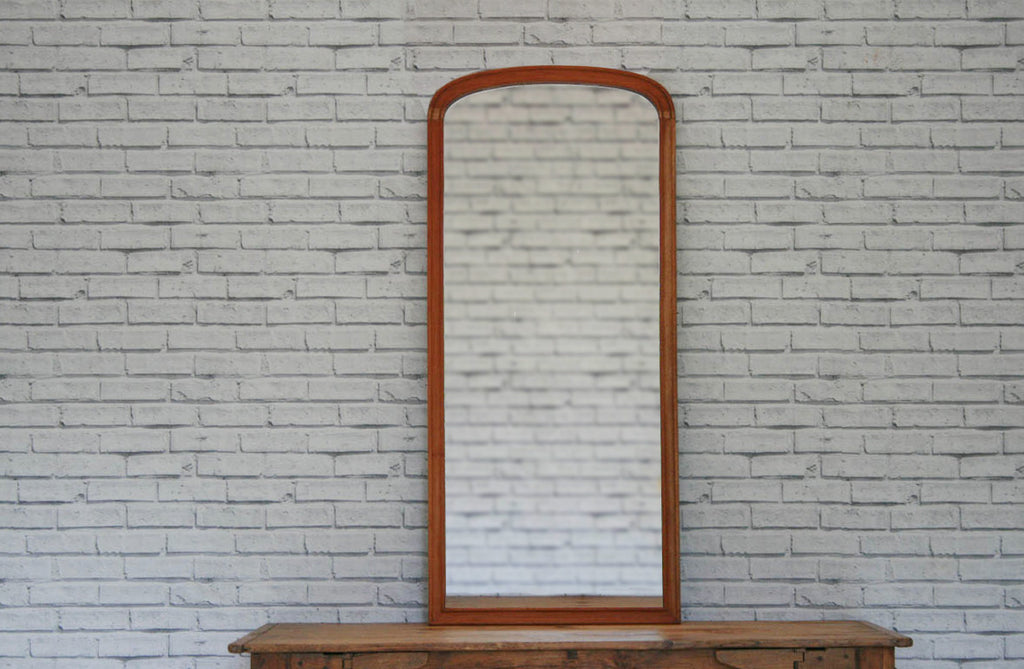 A Victorian mahogany rounded top cheval mirror