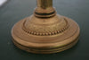 An vintage embossed brass table lamp