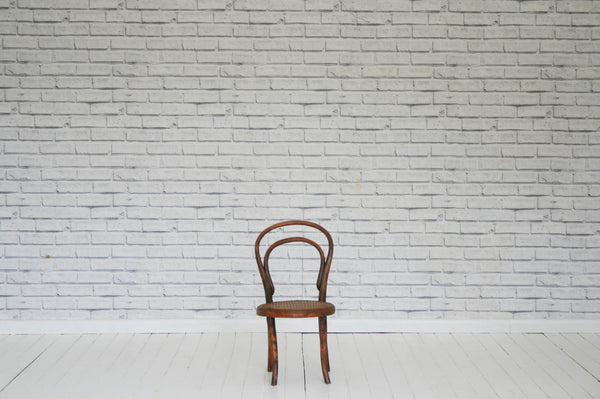 A bentwood kitchen chair with cane seat