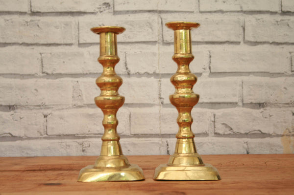 A pair of square base candlesticks