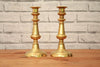 A pair of round base brass candlestick