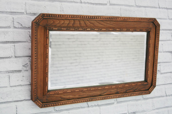 A vintage Oak inlaid mirror