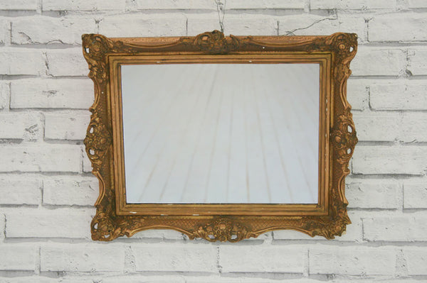 A vintage gilt frame fitted with new mirror