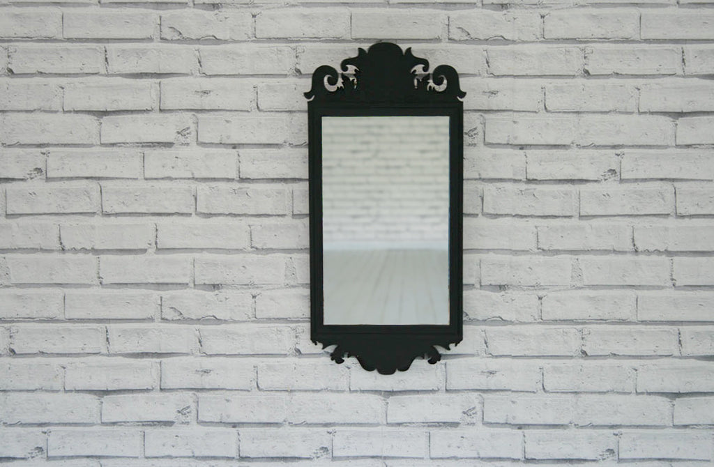 A vintage carved wood mirror