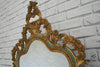 A 1930's gilt framed mirror  with beveled edge