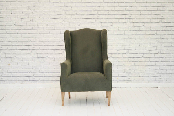 An Edwardian wing back armchair
