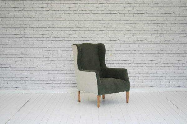 An Edwardian wing back armchair in brushed cotton & ticking