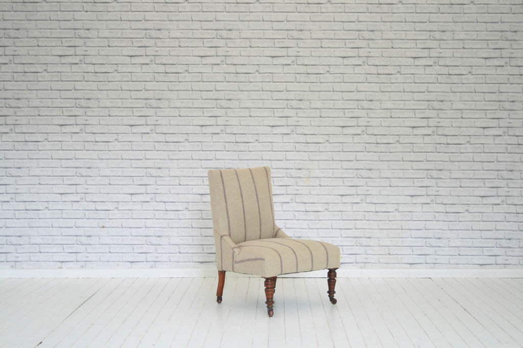 A Victorian nursing chair / bedroom chair in heavy striped linen