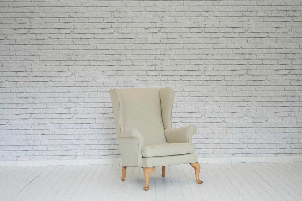 A 1930's Parker Knoll wing back armchair