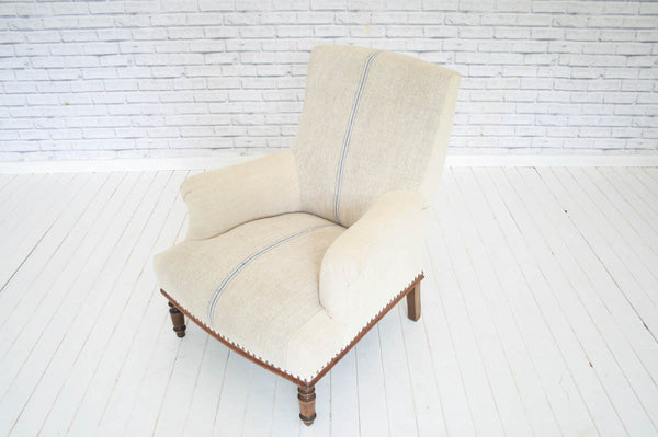 A 1800s French antique armchair in Hungarian sack cloth