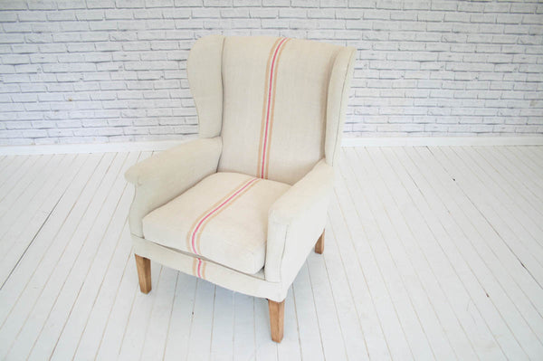An Edwardian wingback armchair in Hungarian sack cloth
