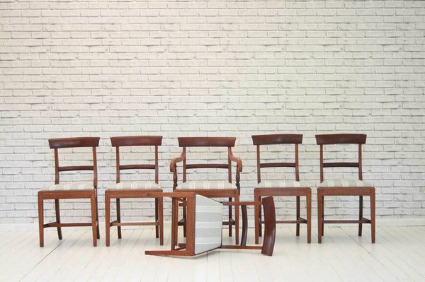 A set of six early 20th century mahogany dining chairs