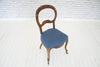 A set of four Regency (1811-1820) dining chairs