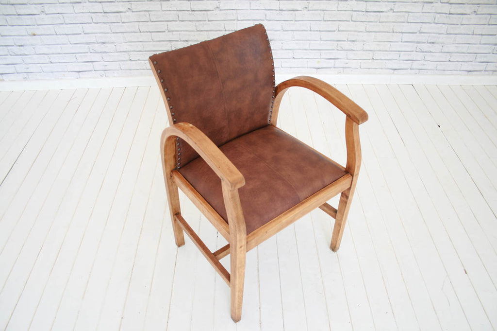 A 1930's/40s desk chair in faux Ostrich leather upholstery