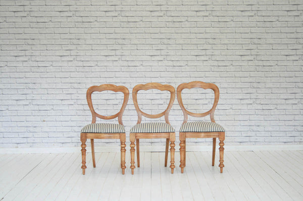 A set of three Victorian pine dining chairs / kitchen chairs