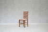 A set of three oak ladder back dining chairs