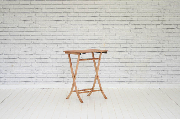A vintage folding side table