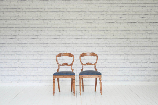 A pair of beautifully carved beech balloon back dining chairs